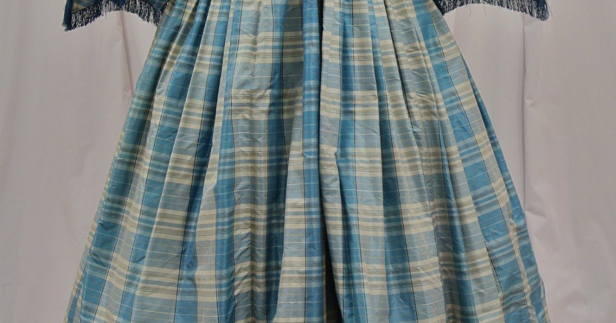 From the merchant's listing:     - Amazing 1850's to 1860's civil war era dress, done in a bright sky blue, black, and white silk that...