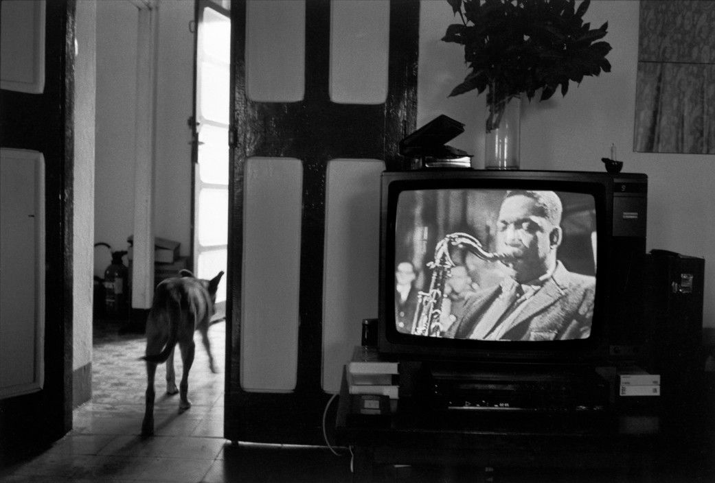 Magnum Photos Photographer Guy Le Querrec EQUATORIAL GUINEA. Bioko island. Malabo. At Guy MAURETTE's home, director of the ICEF Institut Culturel d'Expression Française. Appearing on the television the American jazz musician