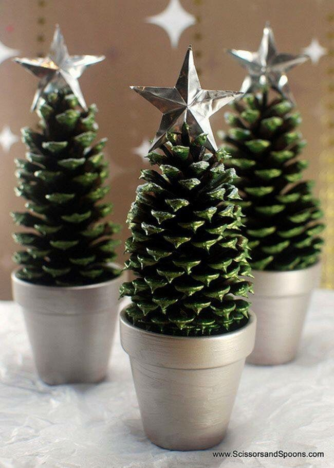 Pinecones dipped in green paint with silver stars. Sitting in painted clay pots.