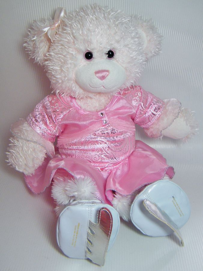 """dfd2f1826b9 Soft bear with pink eyes and pink stitched nose measures 16"""" long. One  piece ice skating dress has silver and white embroidery on bodice and  sleeves  ..."""