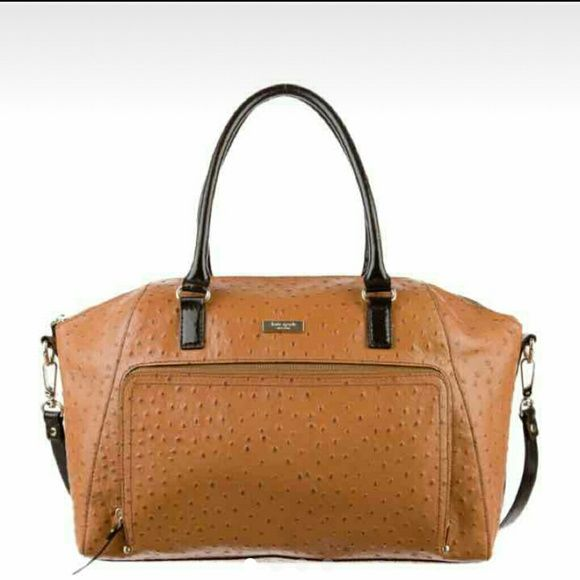 "Kate Spade Catalina Large Cognac Leather Satchel TRADE: $375 Description  100% Authentic Kate Spade Alexander Avenue Catalina Large Cognac Ostrich Embossed Leather Satchel     A stunning bag with classic looks. Great for quick trips, as a carry on or just as a day to day carry all. We ladies LOVE our big statement bags.  Measures 15"" long by 10.5"" tall by 5.5"" wide  Handles / Straps have a drop length of 9""  Longer strap  1 outside zip around pocket  Zip top closure  1 inside zip pocket  2…"