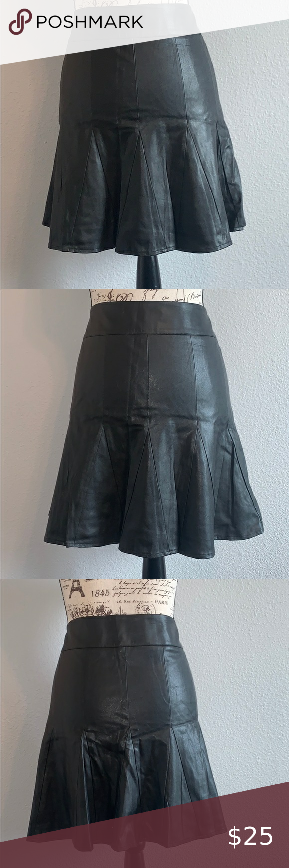 Ann Taylor faux leather skirt.  3/ 0289 Ann Taylor faux leather  skirt with a small flare 18. In. Length .  Side zipper in good working order.Good pre owned condition. Small marks on the waist line from the hanger grips. ( see pics) Ann Taylor Skirts