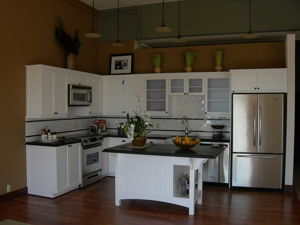 white l shape kitchen design with small beaboard kitchen island and black marble countertop also on l kitchen id=71278