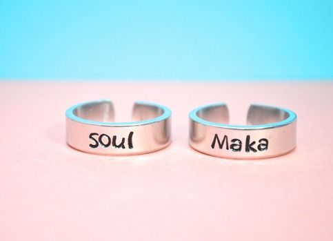I'm getting this for my SO!!! Cute  https://www.storenvy.com/products/10289952-maka-and-soul-adjustable-soul-eater-inspired-aluminum-ring-pair