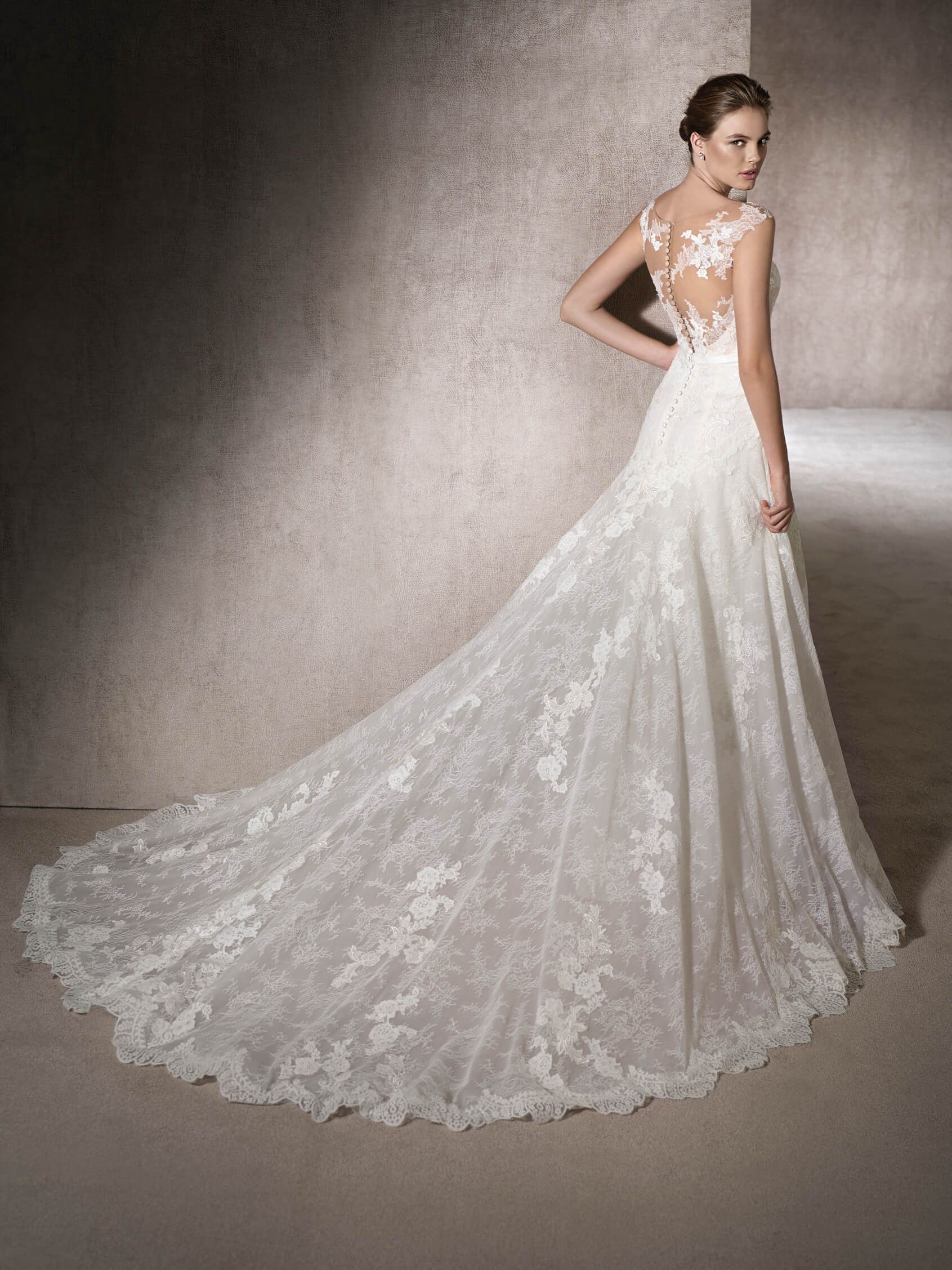 Mikonos is a stunning aline wedding dress in tulle with guipure