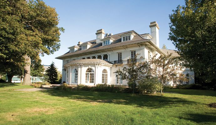 Built in this five-bedroom house sits on the shores of Lake Erie. Listed on  the National Register of Historic Places, the mansion features 10  fireplaces, ...