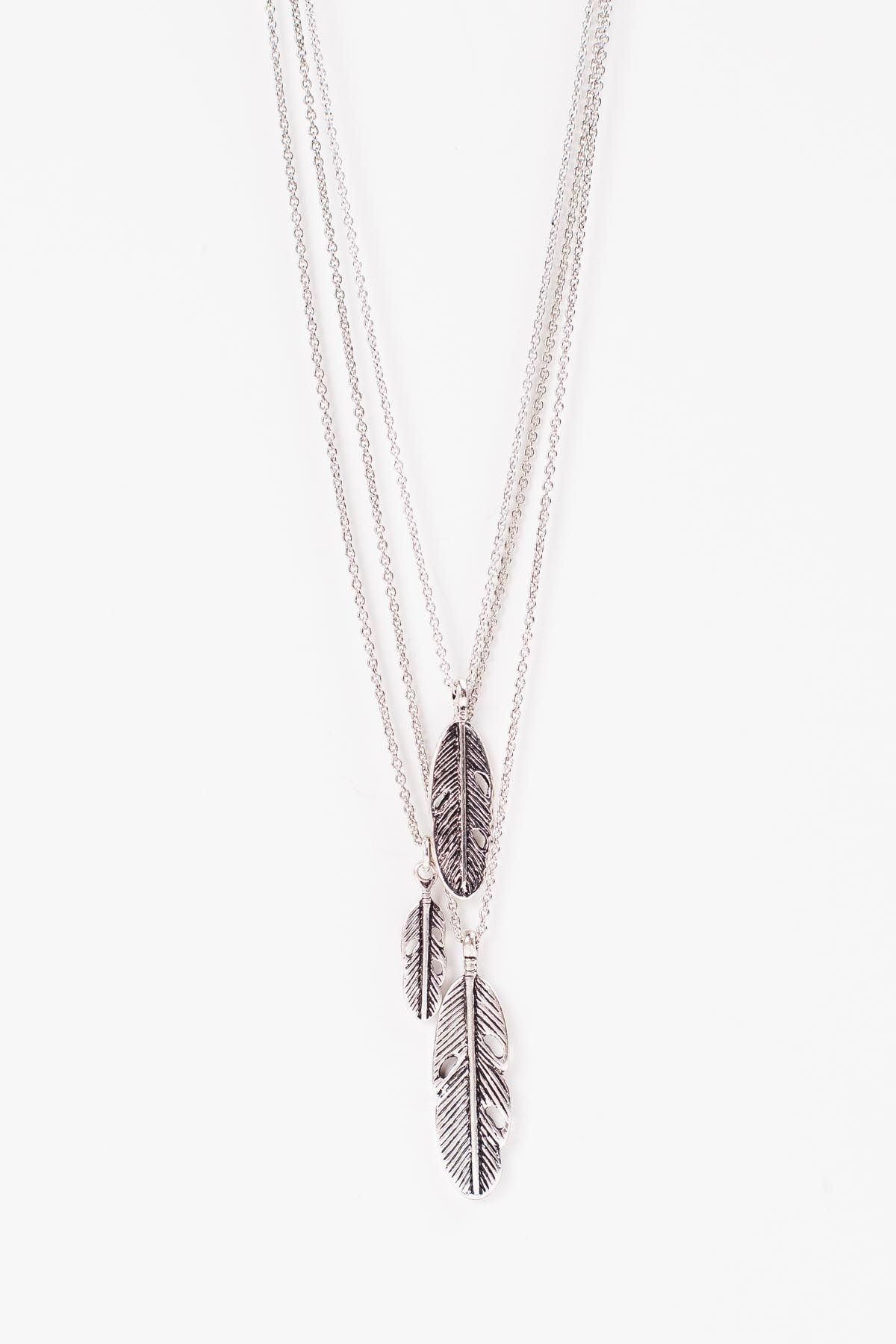 Drop Feather Necklace Three layered silver feathers in varying sizes fall  perfectly. Length  17