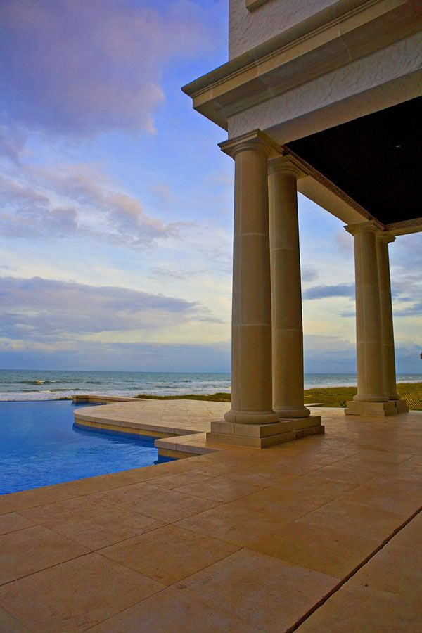 ocean view over back patio and pool, including cast stone columns