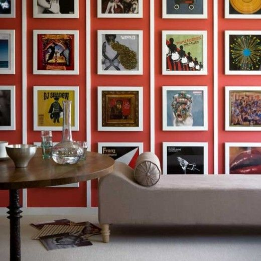 Album gallery wall..great idea..what to do with your old photo albums!