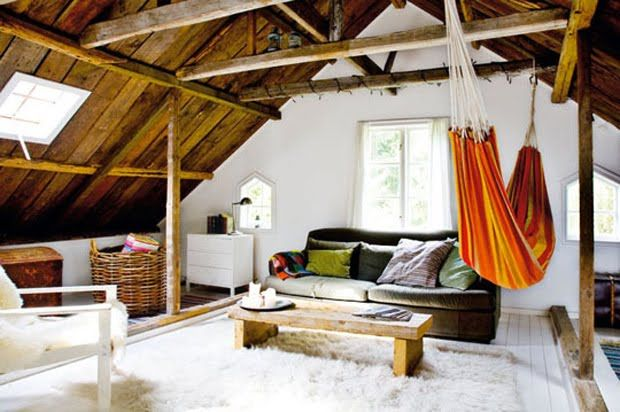 a frame, exposed wood beams, flokati rug, velvet couch annnnndddd hammock. wow.