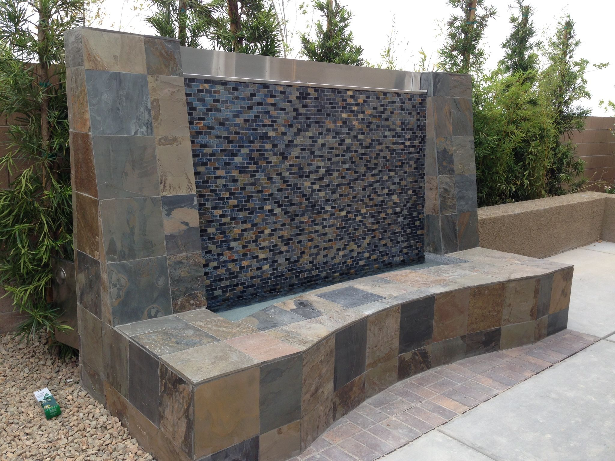 Water feature wall with glass tile.