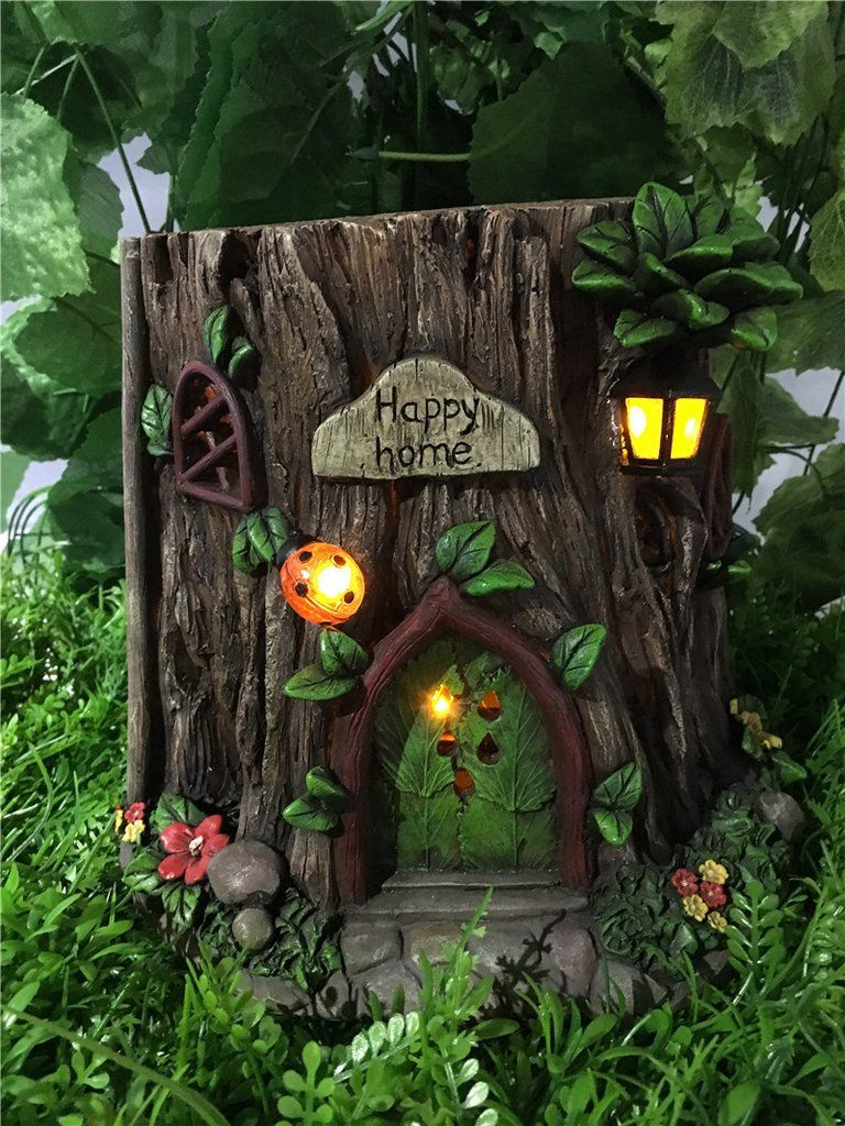 Fairy gardentree trunk house with solar lights garden