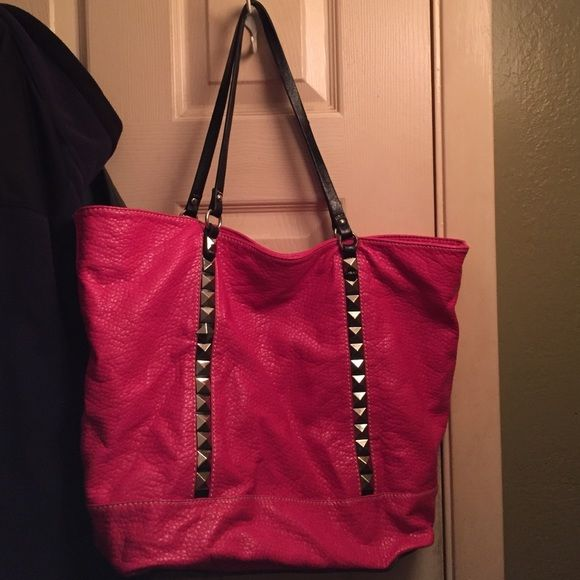 Echo red pink tote with studs Great condition only used once or twice. I have so many totes I never use. Open to offers Echo red Bags Totes