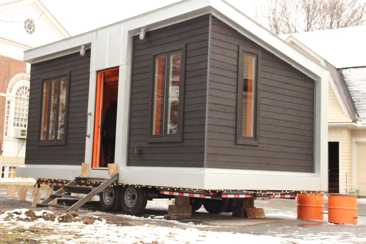 The Tiny Houses Exterior Is Finished With White Cedar