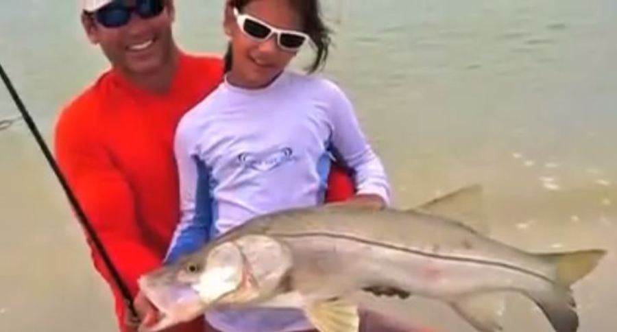 Little Girl, Big Snook: Shore fishing at its finest.