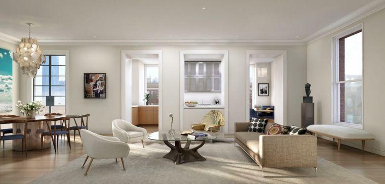 pareti bianche e pavimento in parquet per un soggiorno con tavolo da ...