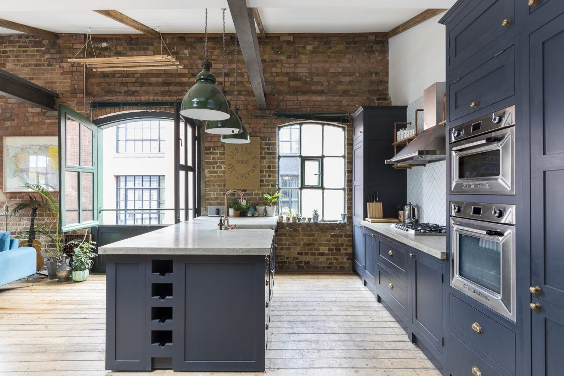 Penthouse kitchen with exposed brick in London
