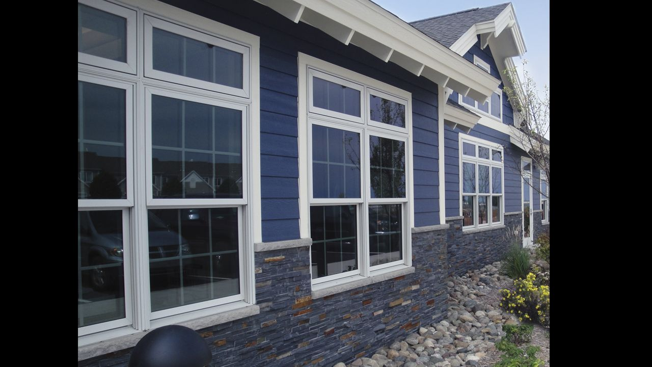 Charcoal ledgestone exterior port austin 39 s visitors center for Austin stone siding