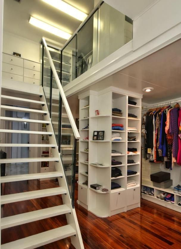 Beautiful Two Story Closet With Wood Floors And Plenty Of Shelves Space Luxury