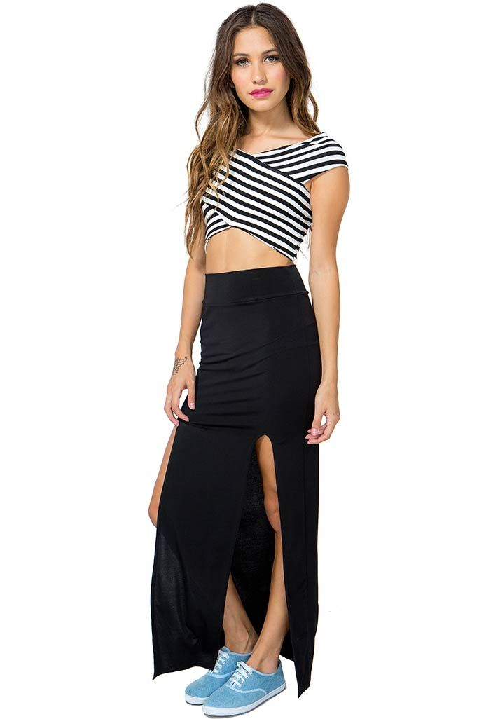 50896ae99 A crazy sexy maxi skirt featuring double thigh-high slits in the front.  Banded waistband. Finished floor-length hem. Unlined. Pair it with a crop  top and ...