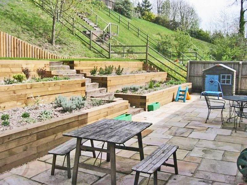 How To Landscape A Sloped Yard Sloped Backyard Landscaping Backyard Hill Landscaping Sloped Backyard