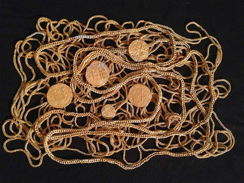 the gold coins and chains were in the wreck of a Spanish sailing ship from the 18th Century. The wreck was located in shallow waters 140 meters off the coast city of Fort Pierce.  ...said the ship was part of a Spanish fleet, which sunk in 1715 on the way back from Cuba in a hurricane. Eleven ships sunk, thousands of people lost their lives. There was treasure worth a total of about $ 400 million from where previously items worth $ 175 million were already recovered.