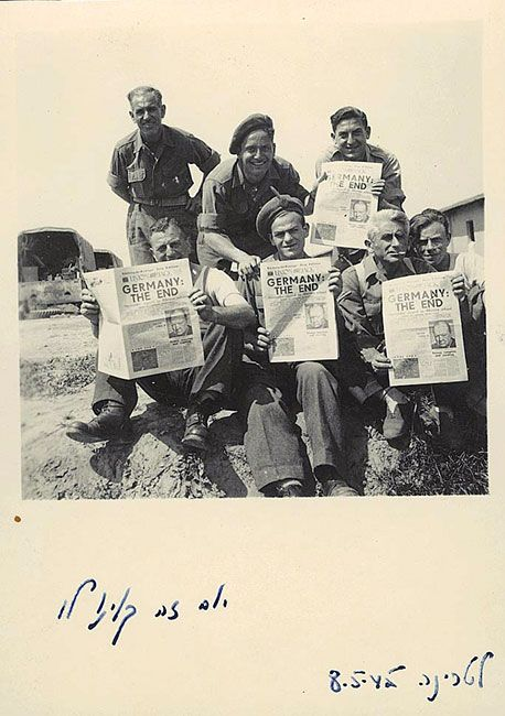 "Laterina, Italy: Jewish Brigade soldiers hold newspapers declaring the war's end. The front page English headline reads: ""Germany: The End"". The Hebrew photo caption reads: ""This Is The Day We Have Been Hoping For – 8 May 1945"". Yad Vashem Photo Archives, 111CO1"