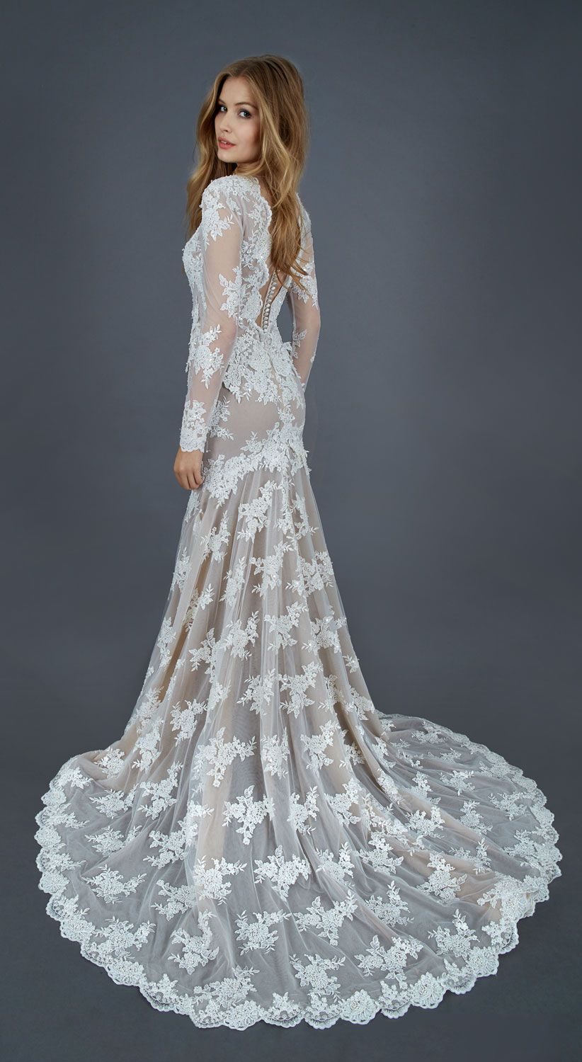 Atelier Eme Mermaid gown with long sleeves and deep V-neck, made of thread embroidered tulle and enriched by hand with pearls, sequins and beads, nude style look.