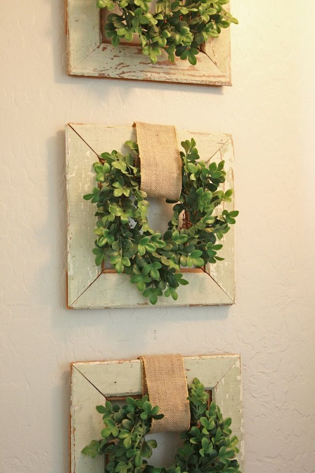Boxwood wreaths on top of frames with burlap \