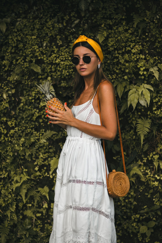 d397b5d8219 Shop white summer dresses at. dress  Lovely Pepa    sandals  Mango     headband  Zara    bag  bought in Bali    sunglasses  Ray Ban    earrings   Adornmonde