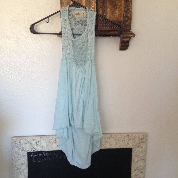 Powdered blue tank top Never been worn, size medium - looks good on small a too. High-low tank top with a showing and lace back by Hollister Hollister Tops Tank Tops