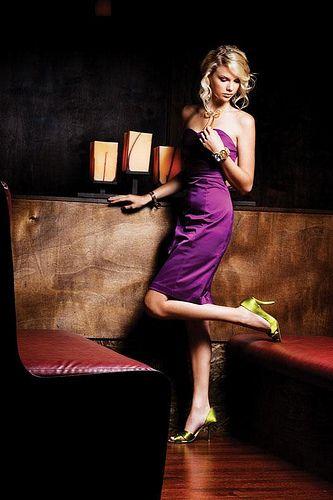 Taylor Swift in a cute purple dress.