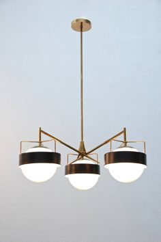 LIGHTING | 1950s Italian Saturn Chandelier. uspension lighting is the perfect contemporary lighting option for every kind of house/apartment/hotel/restaurant/bar and to every corner of it. Bedrooms, bathrooms, living rooms and dining rooms should be enhanced with beautiful and modern chandeliers.| www.bocadolobo.com