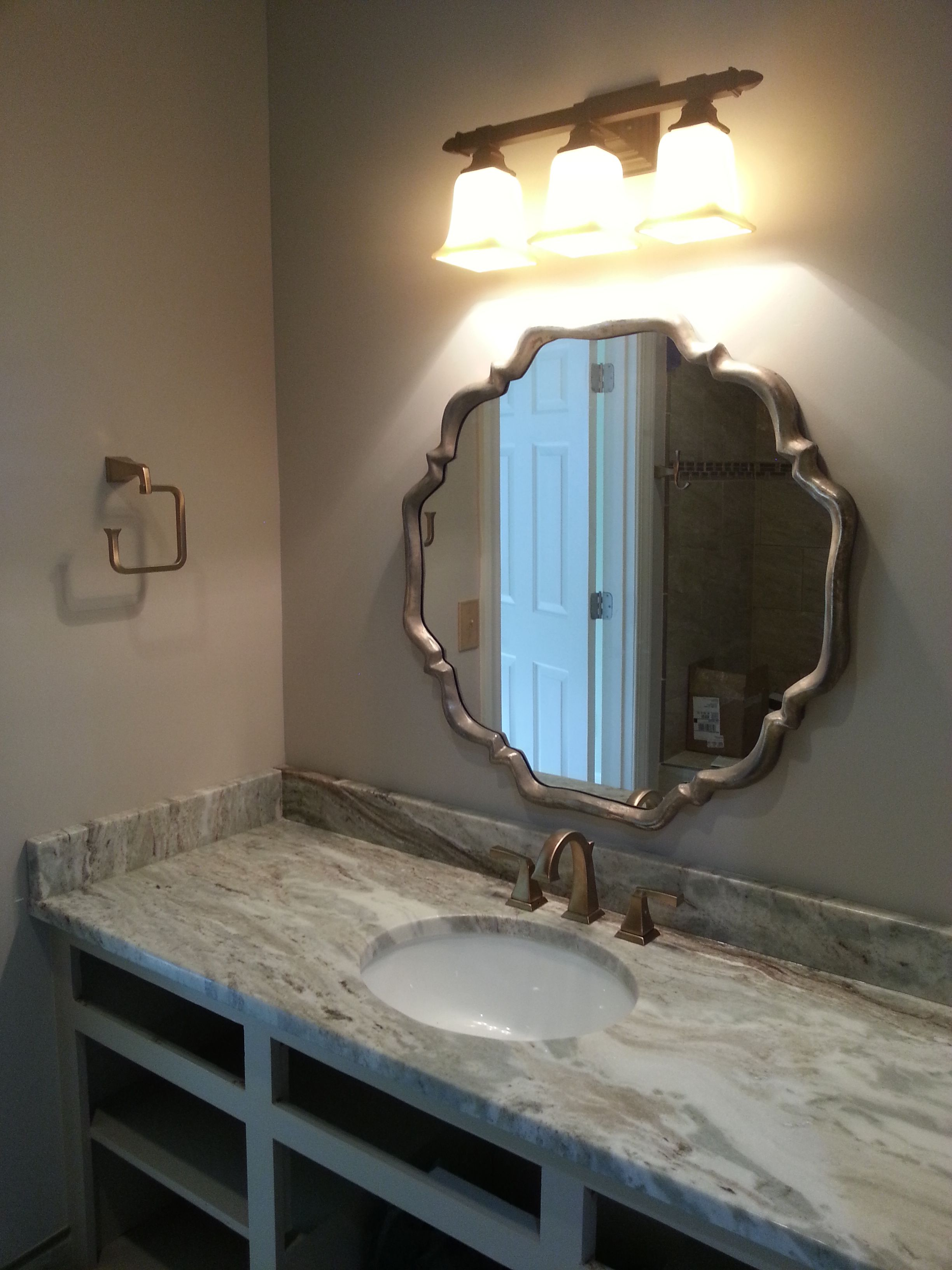 [Ocean Beige quartzite bathroom countertop.]