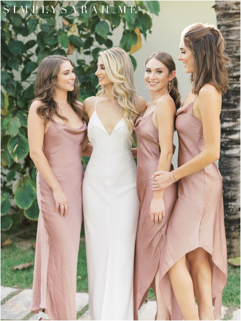 0ade6a0578d A bride and her bridesmaids. These bridesmaids wore peach bridesmaids  dresses that popped perfectly against the tropical island background at The  Cove ...