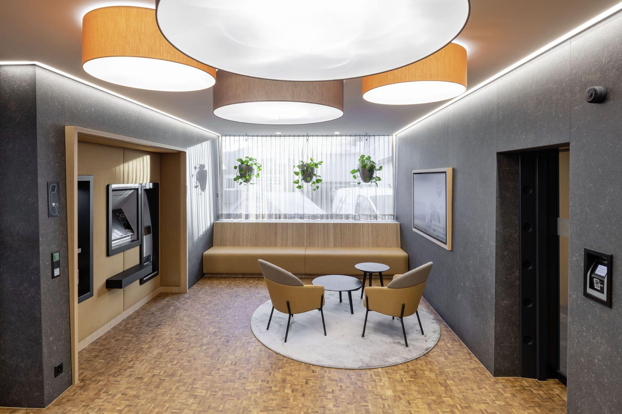 Ademar coffee table and Wam armchair decorates the Raiffeisen Bank branch office in Leuggern, Switzerland.  #Bross #design #designer #furniture #italiandesign #officedesign #workplace #armchair #coffeetable #luxuryfurniture #interiorideas #designinspiration #archiproducts #lovedesign