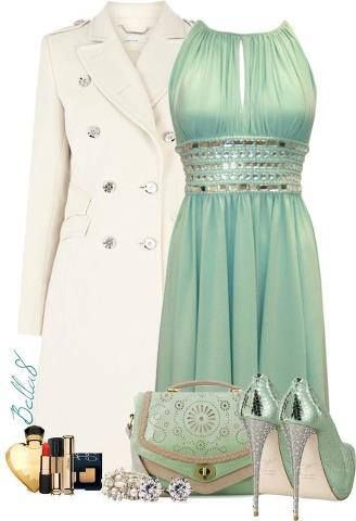 Off white jacket, gorgeous green gown, high heel shoes and hand bag.