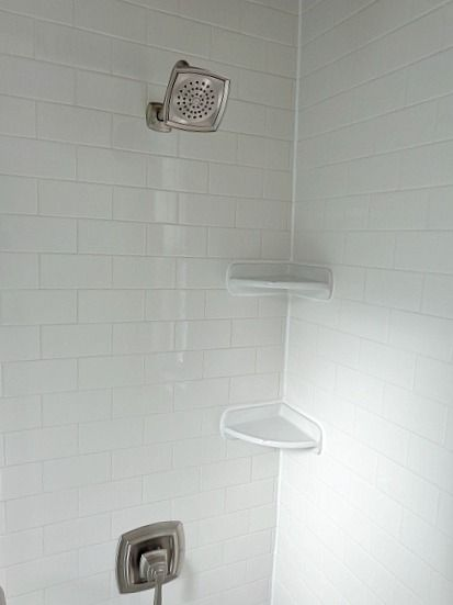 stand up shower faucet. rental bathroom remodel  turned an old tub into a stand up shower Moen Boardwalk faucet with corner shelves