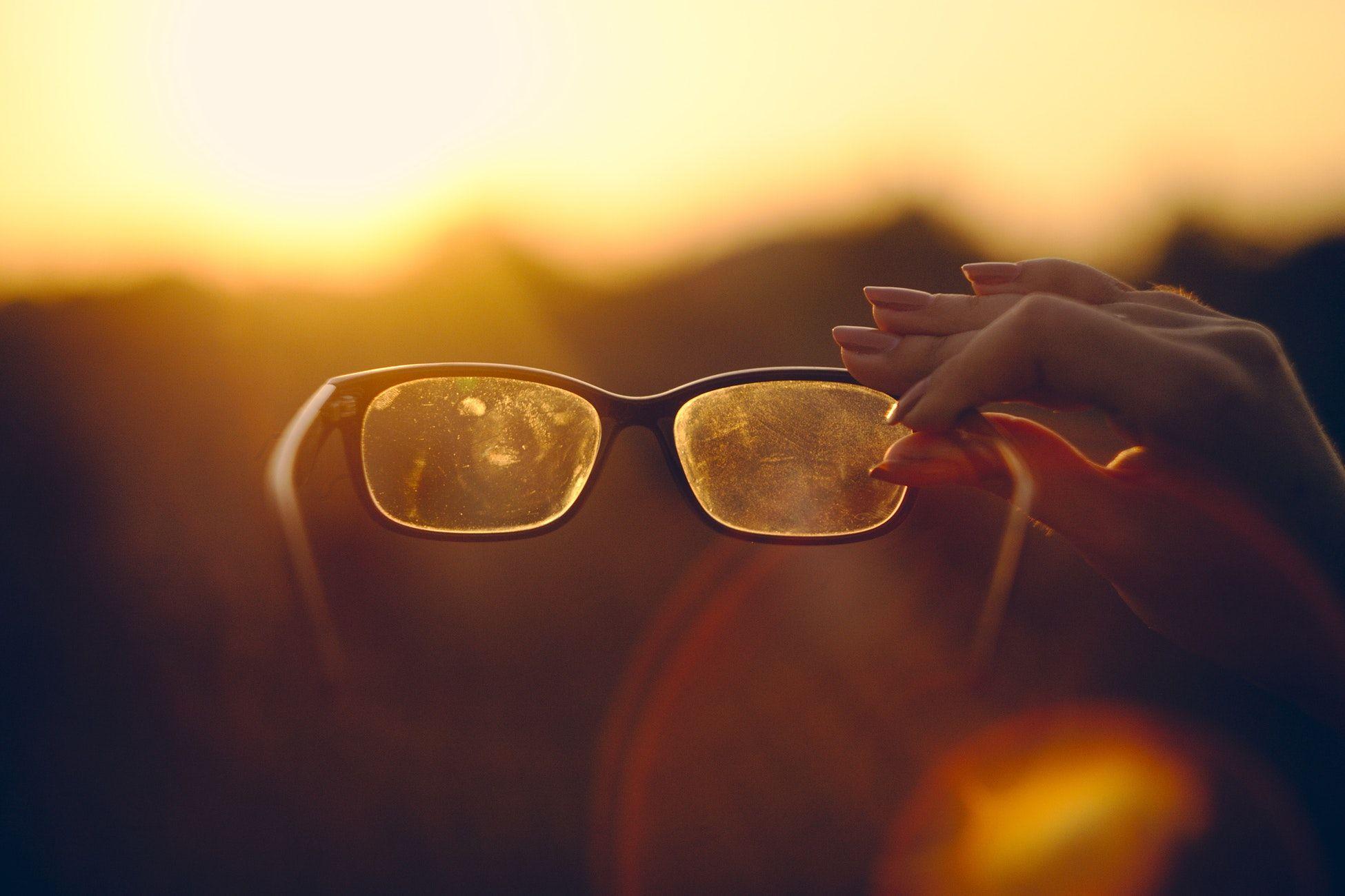 98531cf7b7 focus photo of person holding black framed eyeglasses