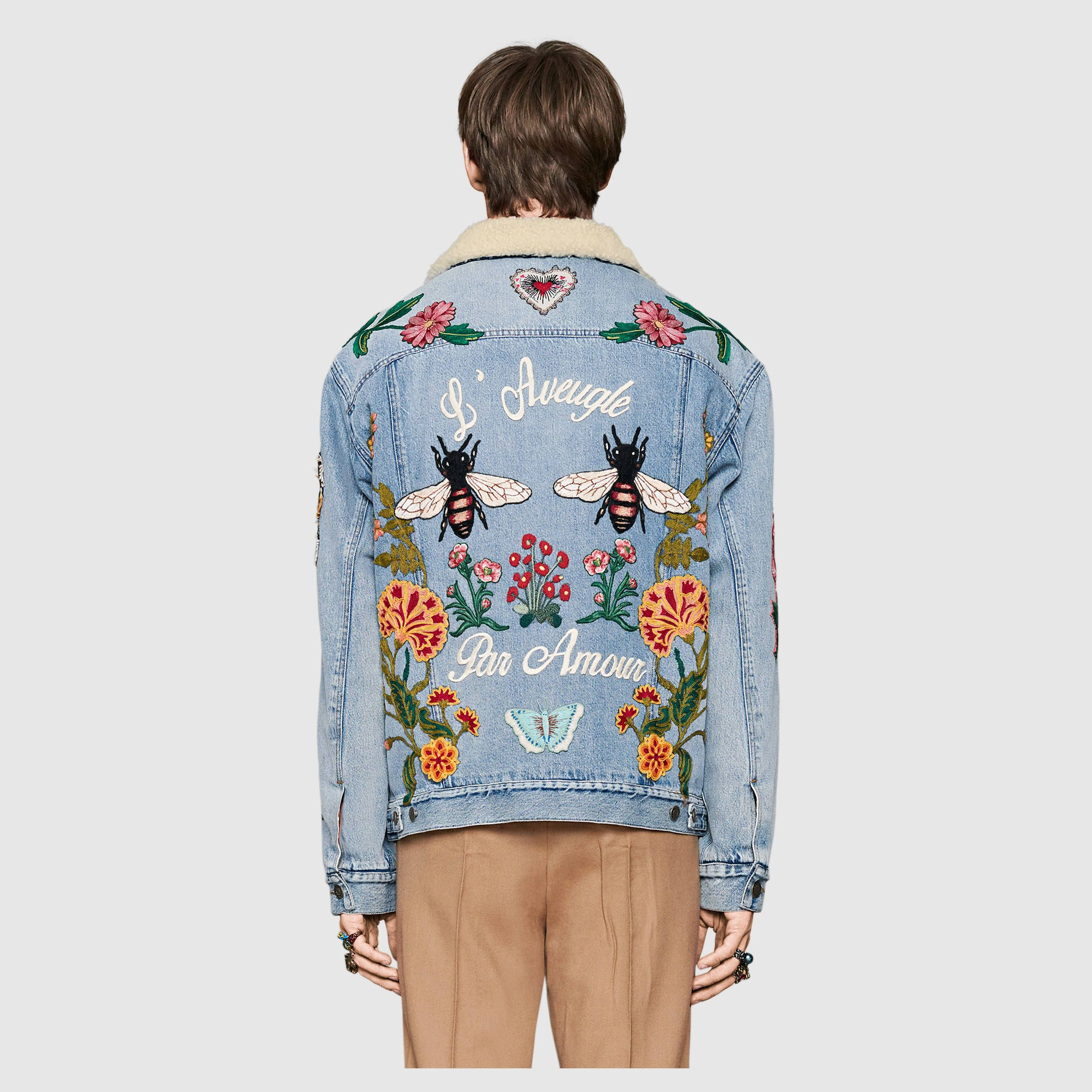 7f3f38166b19 Shop the Embroidered denim jacket with shearling by Gucci. Inspired by a patched  denim jacket