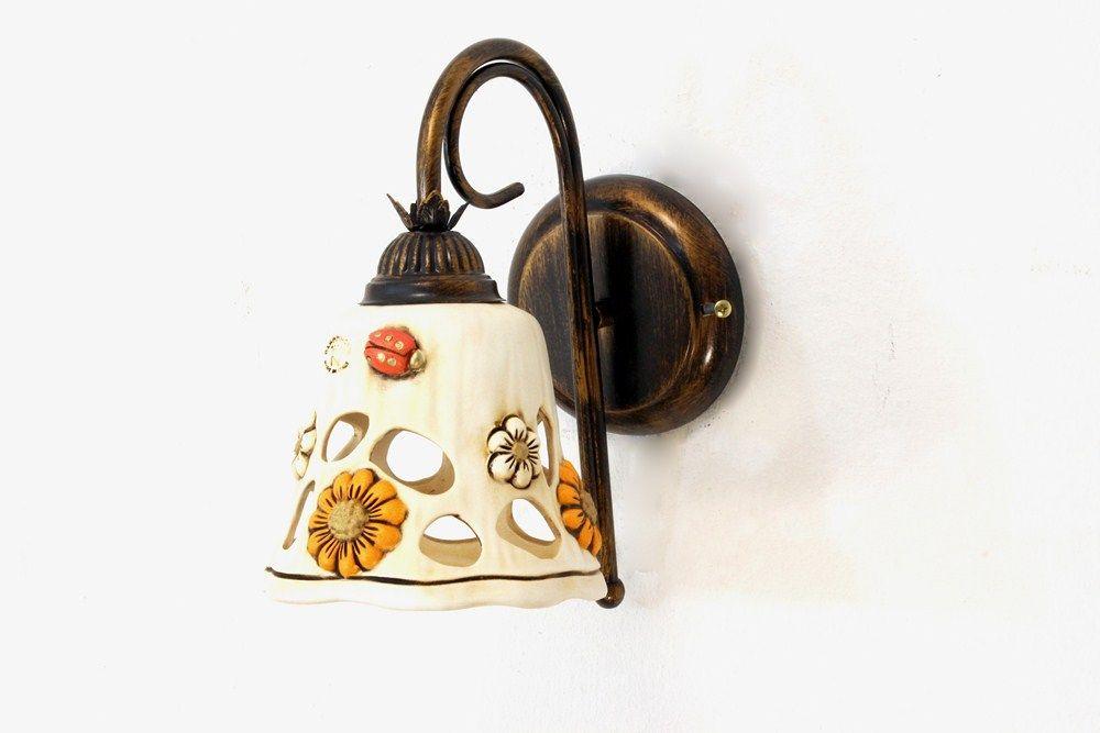Applique a luce ferro battuto e ceramica collezione lampada
