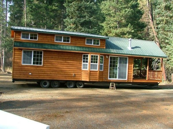spacious cabin on wheels with large windows tiny house pins - Tiny House On Wheels Plans