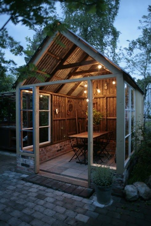 Make A Backyard Party Shed Like This One With Covered Table For Eating Guests