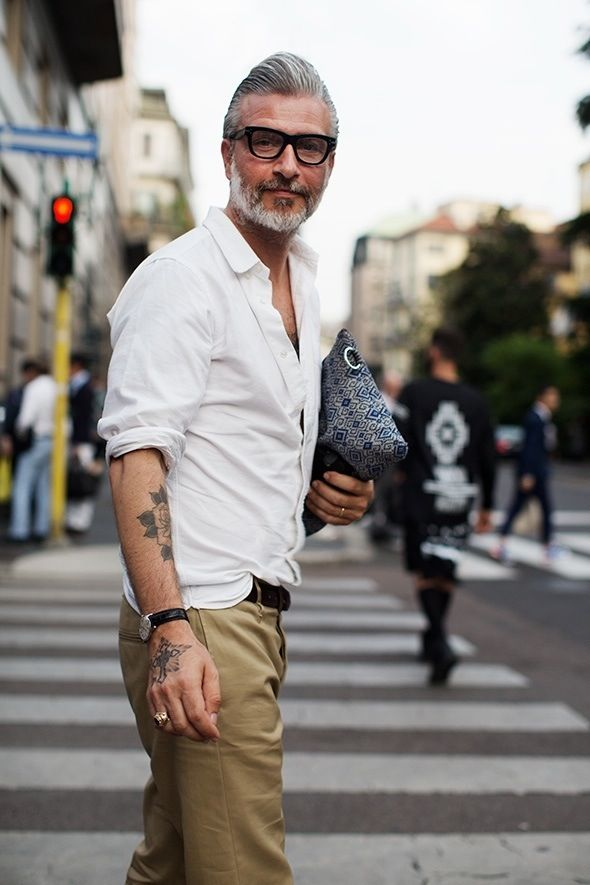 Silver Fox with glasses, tattoo's and manbag!