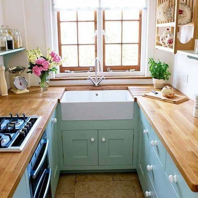 Genial Charning Kitchen Decor For Small Space With Cute Flower And Plants Wooden  Countertop Blue Cabinets