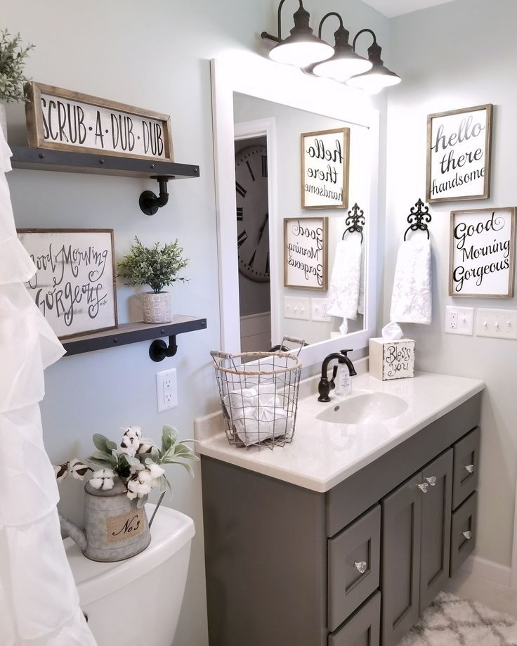 Farmhouse bathroom by blessed ranch farmhouse decor for Ideas for bathroom decorating themes