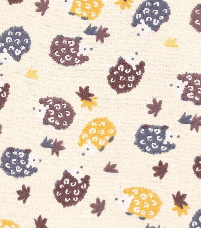 Snuggle flannel fabric uu hedgehogs on cream flannels