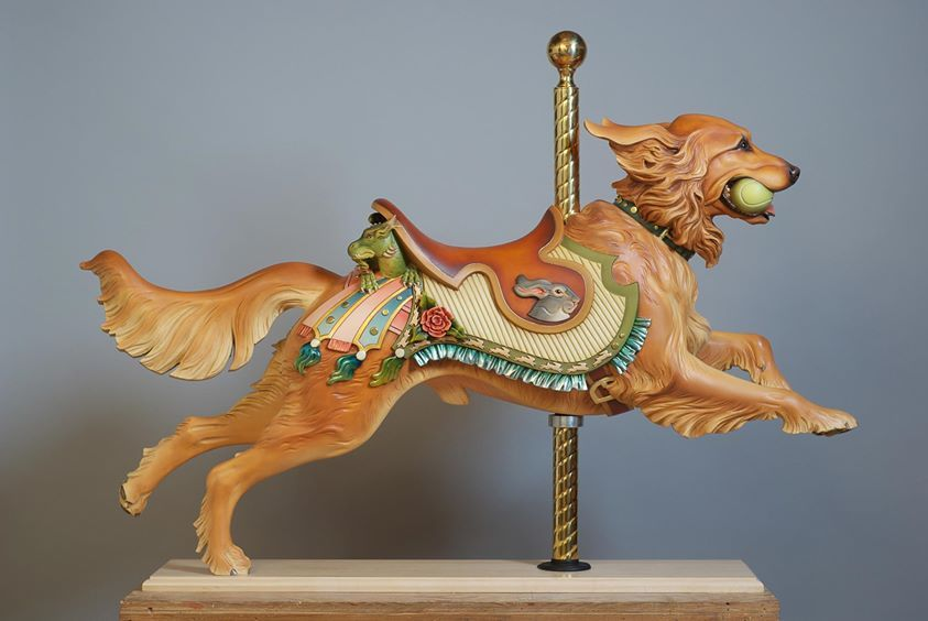 The carved work of Tim Racer commemorates beloved dogs in the style of 19th-century carousel animals.