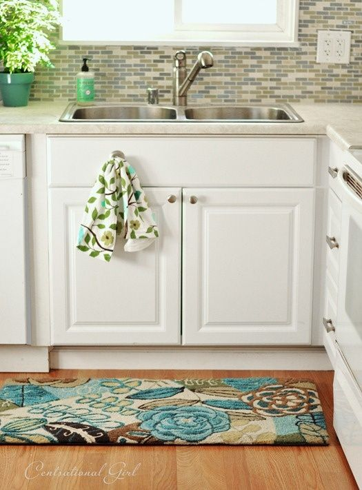 Remodeled kitchen with a colorful Pier 1 Cloud Step Blue Floral Rug ...