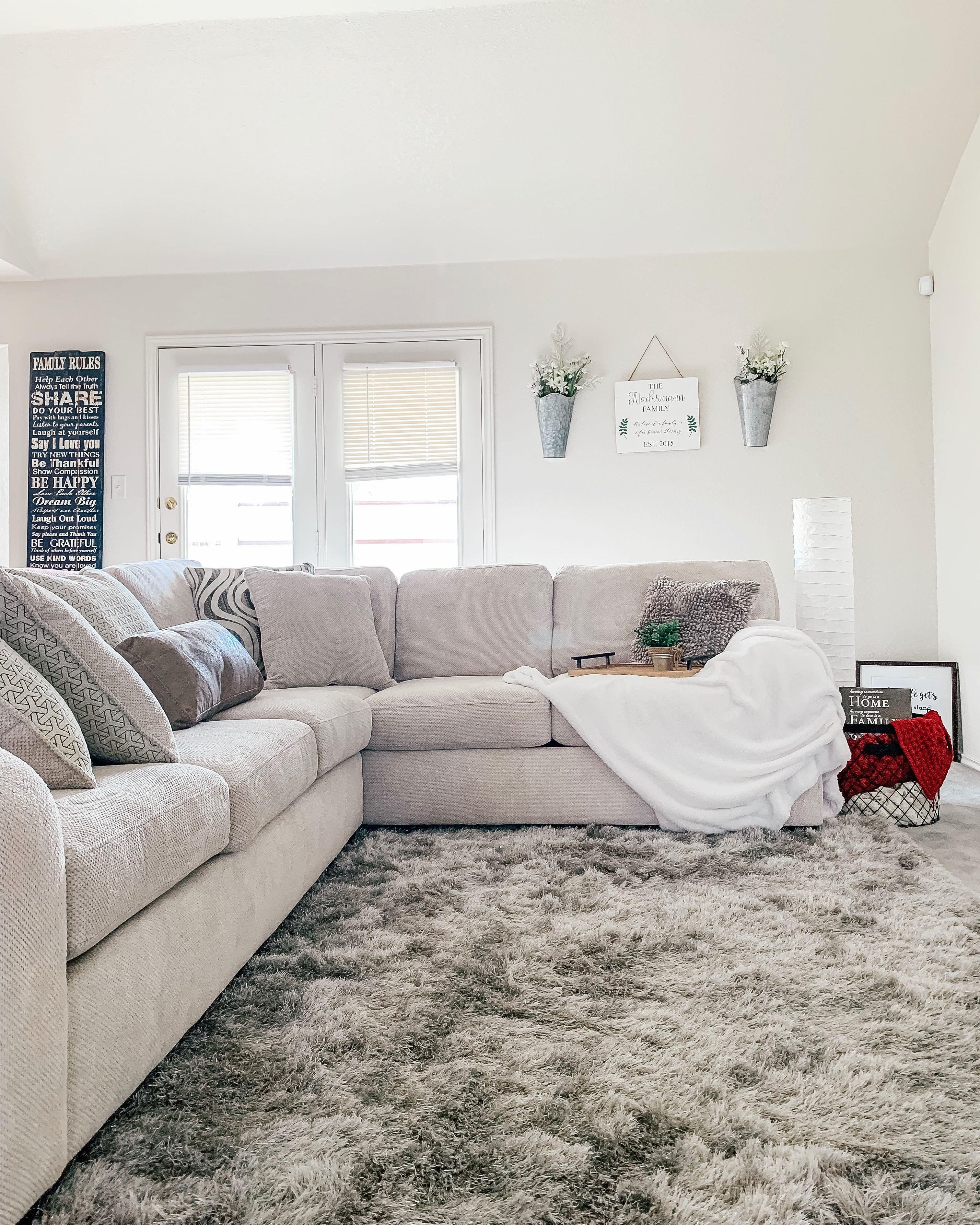 Beige Sectional Couch With Gray Shag Sparkly Rug